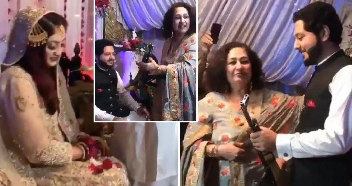 Bride Left Stunned As Her Mum Gifted Kalashnikov To Her Husband in Pakistan